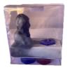 estatua del rostro de san charbel con vela hexagonal